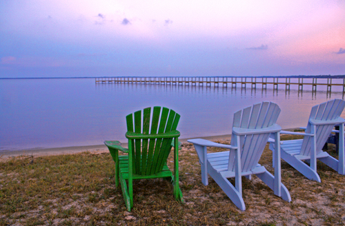 beach chairs set up in front of an inlet on the beach in the Florida Panhandle