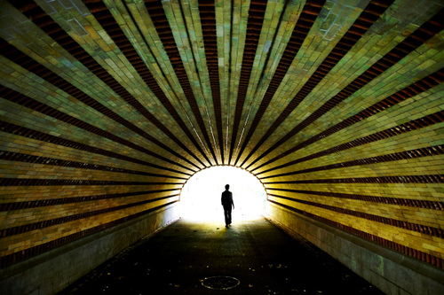 a silhouette of a man in a tunnel in Central Park in New York City