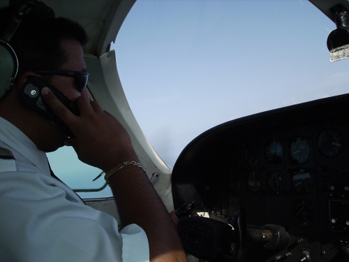 Pilot talking on the phone in the cockpit