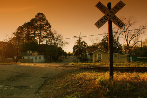 railroad crossing near sunset in savannah, georgia