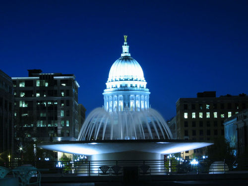 the fountain in front of the Wisconsin State Capitol at night in Madison