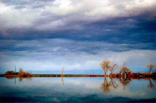 cloudy sky perfectly reflected on a lake near Fort Collins, Colorado