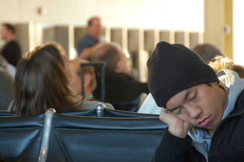 guy sleeping in the airport