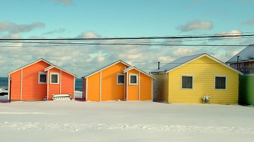 three colorful houses on lake huron in michigan