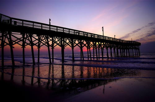 A pier in Myrtle Beach, South Carolina at sunrise
