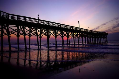 A pier in Myrtle Beach, South Carolina at sunrise