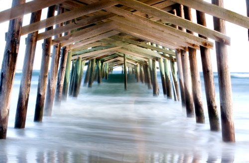 waves underneath the Sportsman's Pier in Atlantic Beach, North Carolina