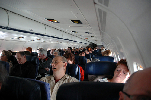 people sleeping on an american airlines flight