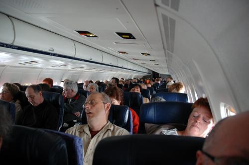 people sleeping on an american airlines flight